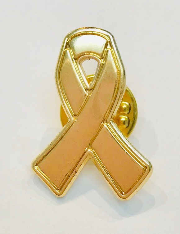 Gold ribbon pin badge